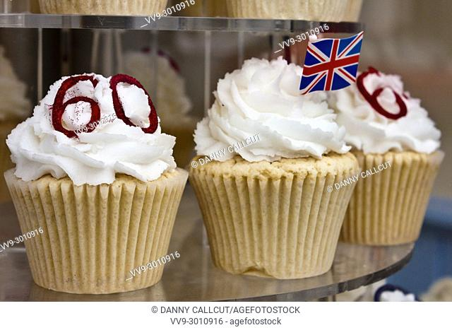 Detail of cupcakes in bakery window commemorating the 60th Jubilee celebrations of Her Majesty Queen Elizabeth II of the United Kingdom