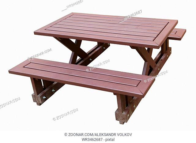 Standard wooden benches and a small restaurant table on a sandy sea beach. Isolated on white with patch outdoor object