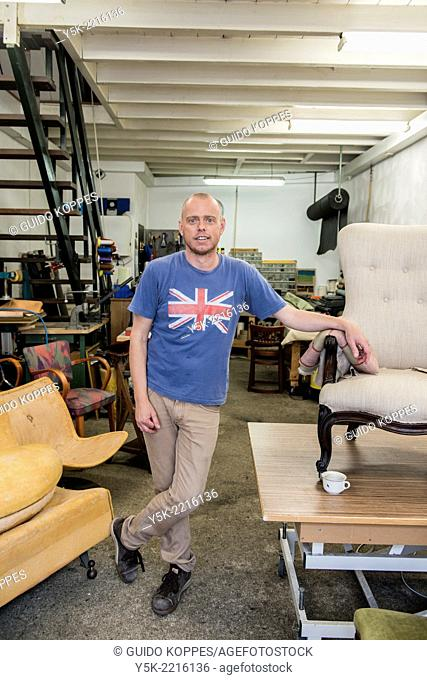 Tilburg, Netherlands. Werner assistes his male partner Josef, who works as an independent upholsterer in his own workshop, down town Tilburg