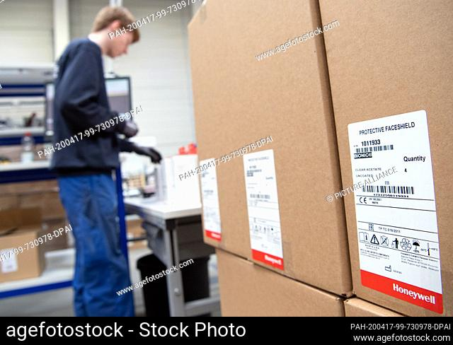 16 April 2020, Brandenburg, Großbeeren: Parcels with Protective Faceshild (protective masks) from Honeywell are available from the logistics service provider...