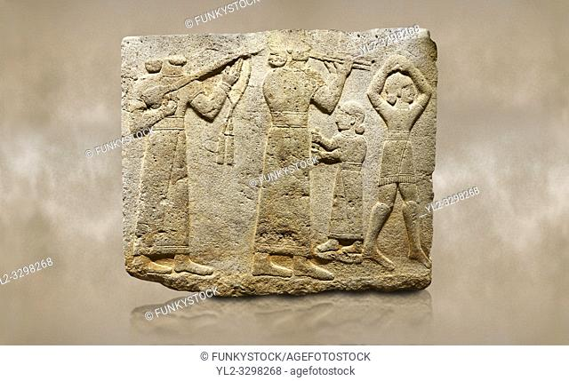 Photo of Hittite monumental relief sculpted orthostat stone panel of Procession. Limestone, Karkamıs, (Kargamıs), Carchemish (Karkemish), 900-700 B