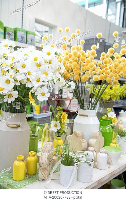 Various artificial flowers for sale in garden centre, Augsburg, Bavaria, Germany