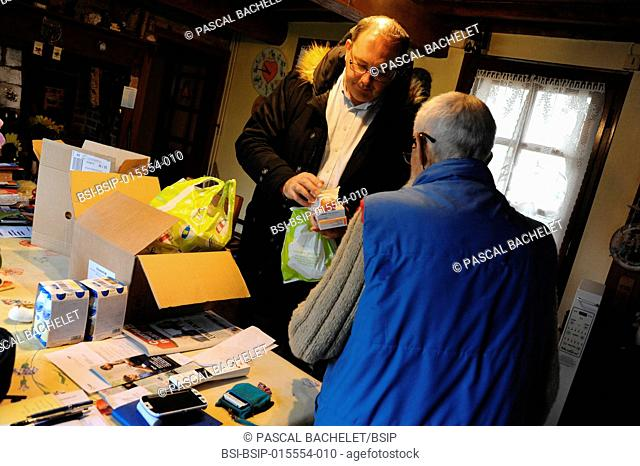 Reportage on a rural pharmacy technician during his home delivery round in Auxi-le-Château, France. Visting a couple who don't have a car