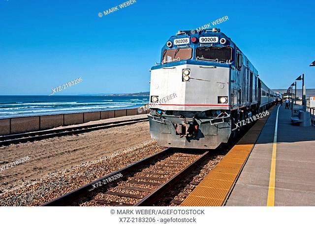 Santa Barbara, The Pacific Surfliner Amtrak passenger train at Surf Beach near the city of Lompoc in southern California