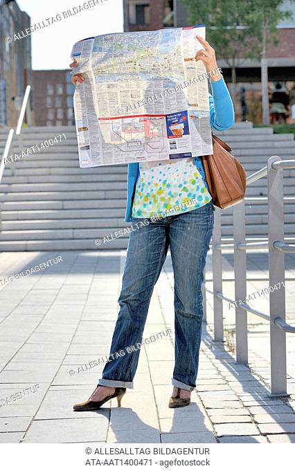 Woman with a city map