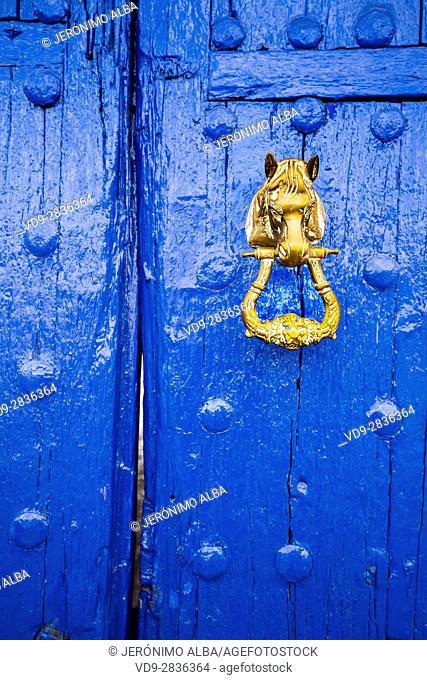 Blue entrance door and door knocker. Venta del Quijote. Puerto Lapice, Ciudad Real province, Castilla La Mancha, Spain Europe