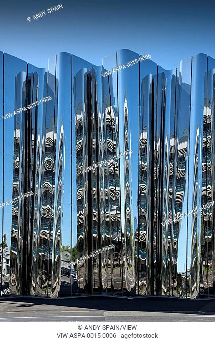 Front elevation of exterior facade with abstract reflection. Len Lye Centre, New Plymouth, New Zealand. Architect: Patttersons Associates, 2015