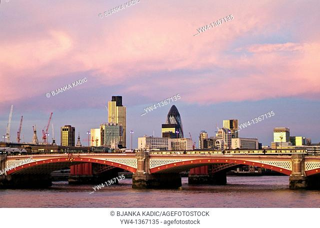 City skyline including the NatWest Tower and Swiss Re Tower at dusk, London, UK