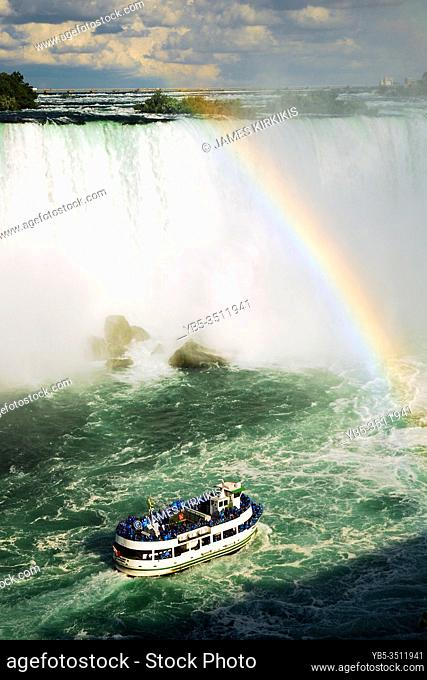 The Maid of the Mist heads towards Horseshoe Falls and a rainbow in Niagara Falls
