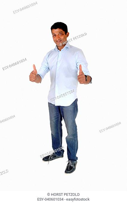 A full body image on an East Indian man in jeans and blue shirt standing.with booths of his thumps up, isolated for white background