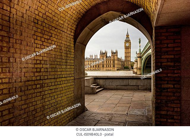 View of Big Ben and Houses of Parliament, seen through archway, London, England