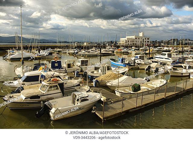 Boat at Puerto Chico Marina, harbor and promenade on the seafront, Cantabrian Sea Santander. Cantabria Spain. Europe