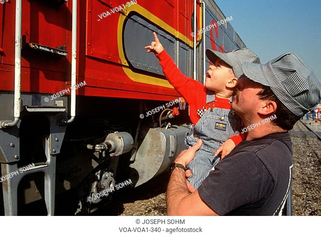 Father and son looking at historic trains, Santa Fe, New Mexico