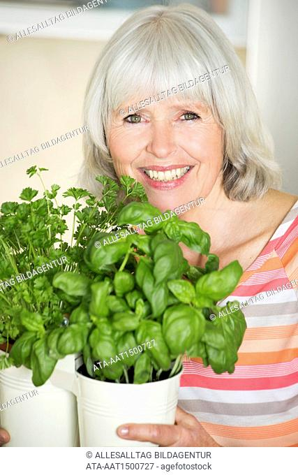 Elderly woman with herbs