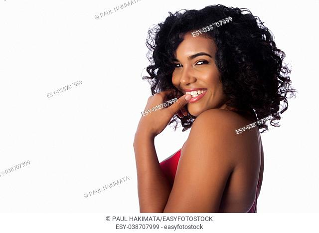 Beautiful face of smiling woman with curly hair on white