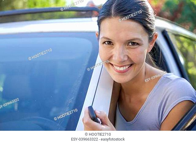 brunette attractive woman shows her new keys for her car