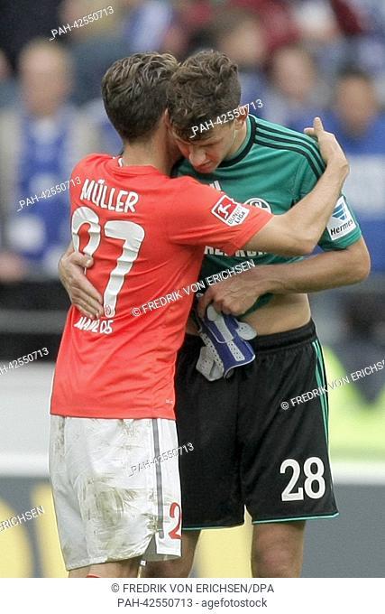 Mainz's former Adam Szalai (2-R) now with Schalke exchanges jerseys with Mainz's Nicolai Mueller after the German Bundesliga match between FSVMainz 05 and...