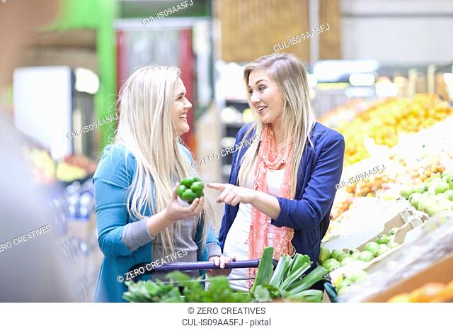 Two young women shopping in indoor market