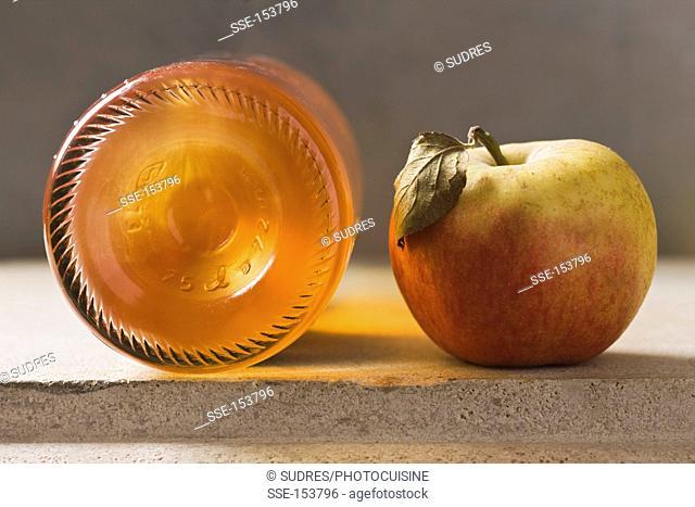 Apple and bottle of cider