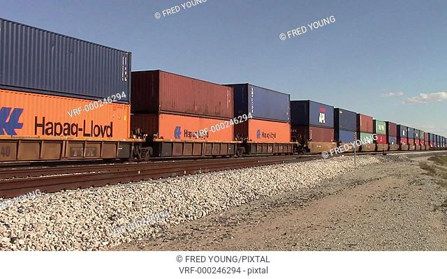 Picacho, AZ, USA - October 18, 2014: Freight train containers moving along the track