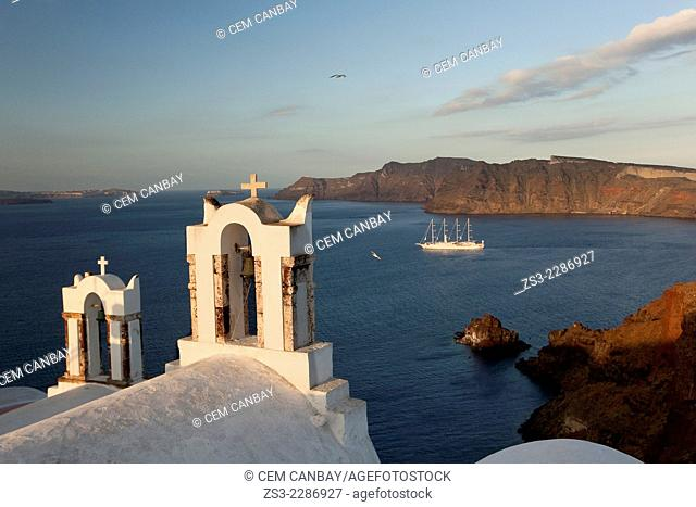 View to the Caldera from Oia town with the white bell towers of a church in the foreground, Santorini, Cyclades Islands, Greek Islands, Greece, Europe