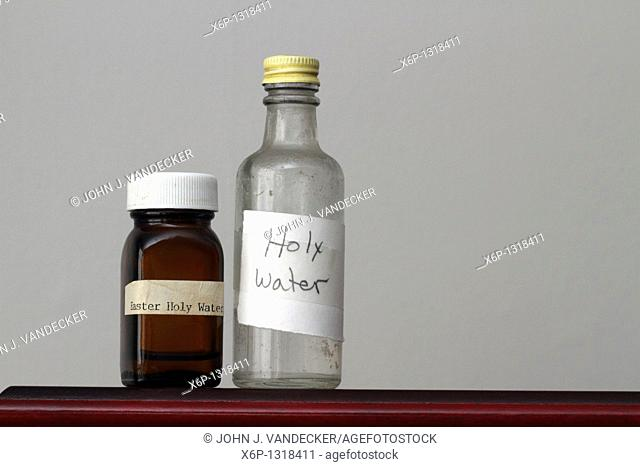 Two old bottles containing Holy Water