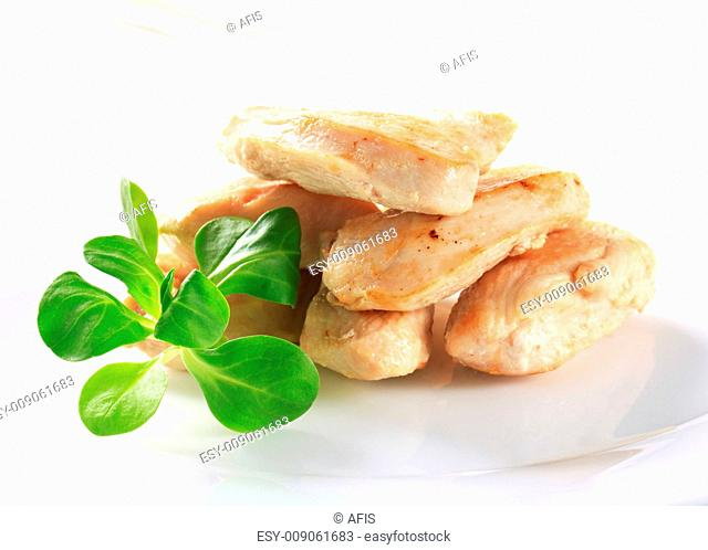 Cooked chicken breast fillets with lamb's lettuce