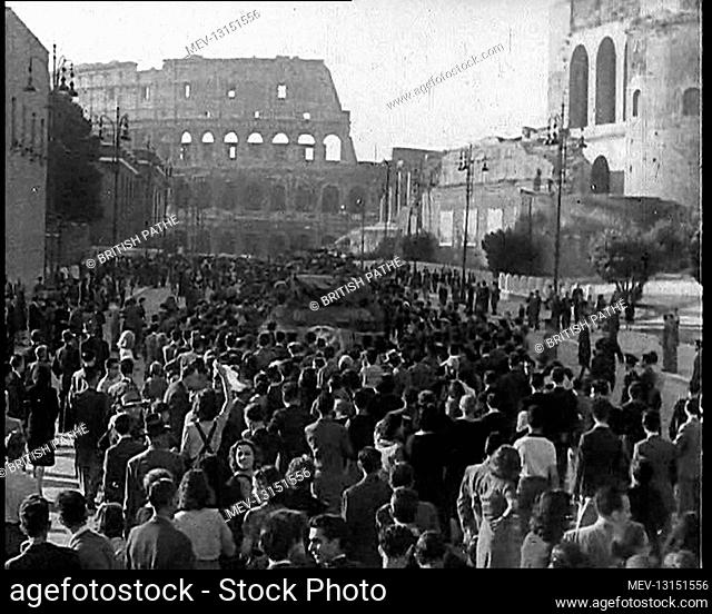 Italian Crowds Gathering Around an American Tank With the Ruins of the Colosseum in the Background - Rome, Italy