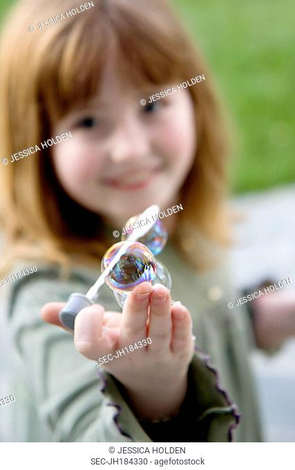 Picture of girl (8-9) showing bubble wand