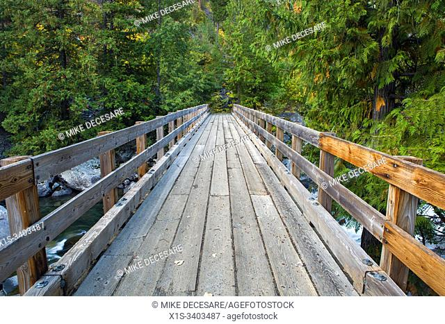 A sturdy wooden bridge for hikers spans Icicle Creek along the Snow Lake trail in the Alpine Lakes Wilderness area in North Central Washington