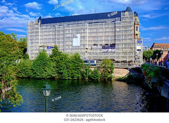 Scaffolding with safety net on 'Gallia' student residence building undergoing renovation, Strasbourg, Alsace, France