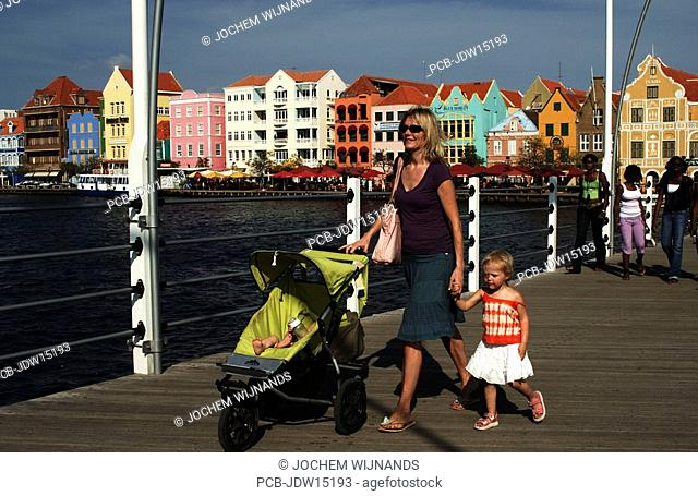 Netherlands Antilles, Curacao, a mother with buggy and toddler crossing the Emma bridge of Willemstad, punda