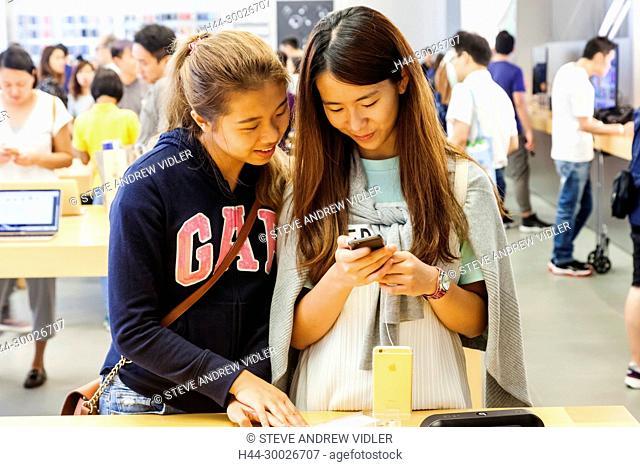 China, Hong Kong, Causeway Bay, Apple Store, Customers Looking at Products
