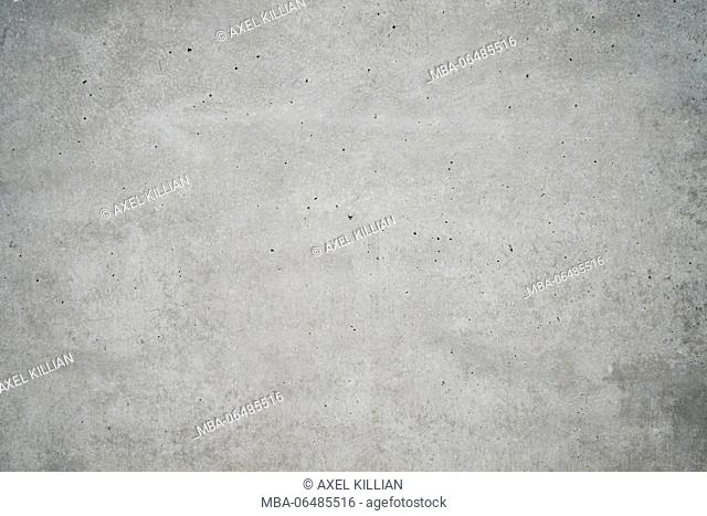 Concrete grey wall with structure and inclusions as a background