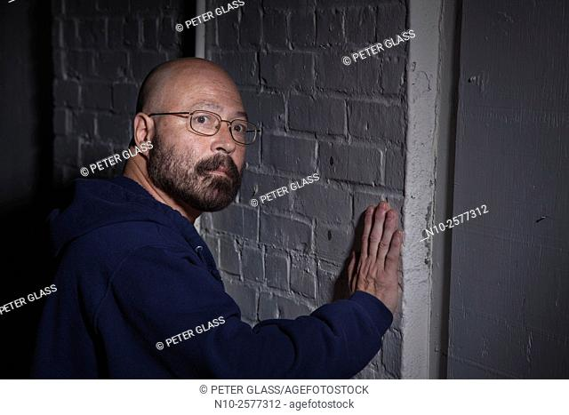 Middle age bald man with glasses and a beard