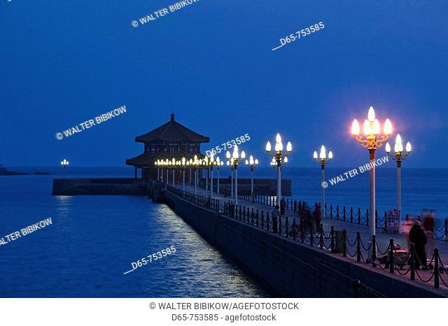 China. Shandong Province. Qingdao: Qingdao Old Town. Huilan Pavillion on Qingdao Bay, evening