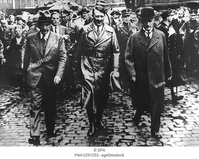 German industrialist Gustav Krupp von Bohlen und Halbach (r) and Adolf Hitler (m) during a visit to the Krupp Factory in Essen