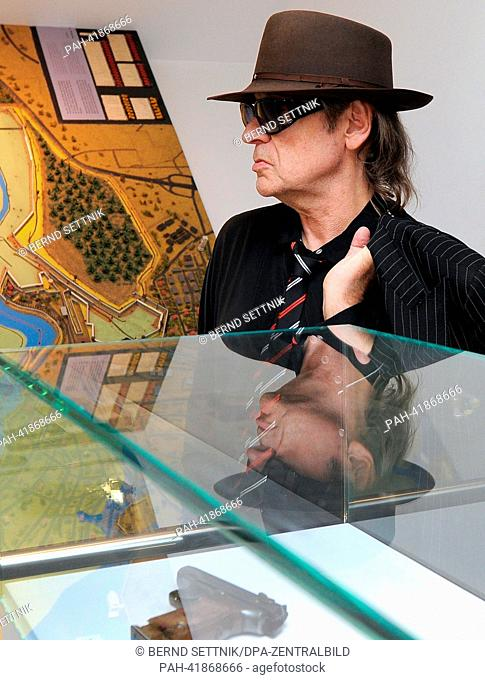 German rock musician Udo Lindenberg walks through the permanent exhibition at Villa Schoeningen in Potsdam, Germany, 19 August 2013
