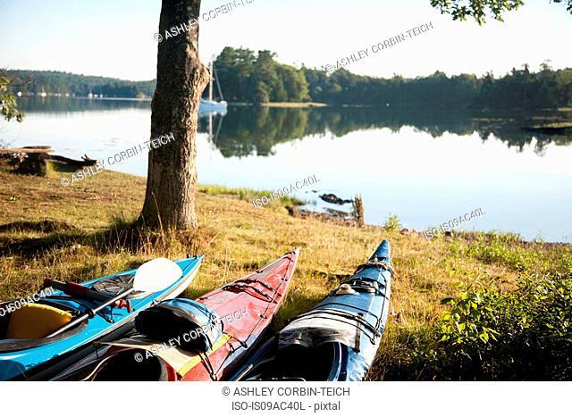 Canoes on lakeside, Bath, Maine, USA