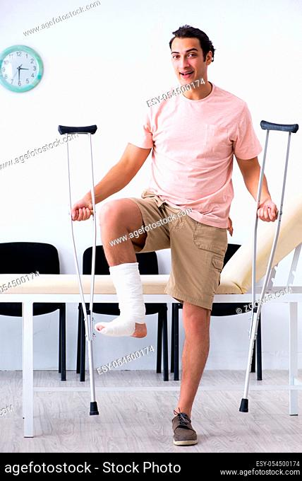 The young injured man waiting for his turn in hospital hall