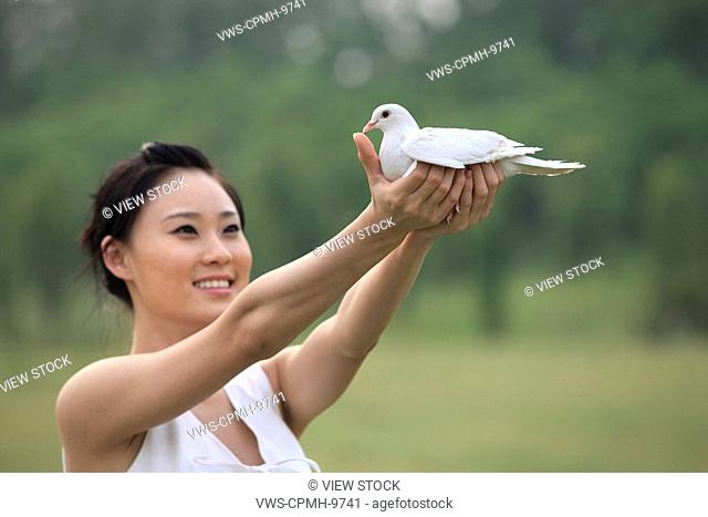 Chinese Woman Holding Pigeon,Beijing,China