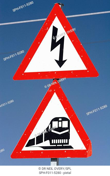 Railway crossing and electricity warning sign