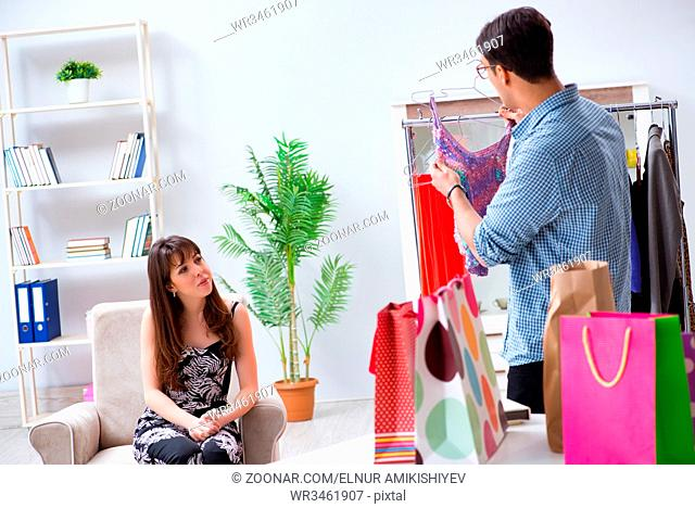 Shop assistant helping woman with buying choice