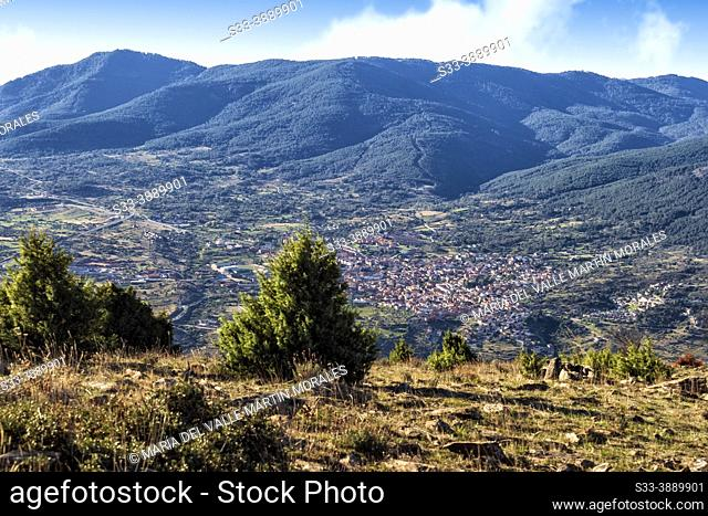 El Tiemblo village fron Meerina hill and Sierra de Gredos on the background. Avila. Spain. Europe