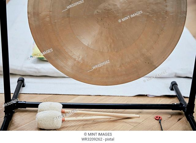 A large brass gong used for sound therapy