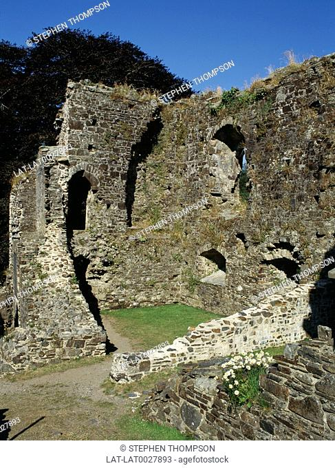 The remains of Okehampton castle above the rushing River Okement was begun soon after the Norman Conquest as a motte and bailey castle with a stone keep
