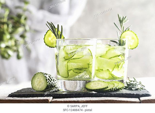Glasses with fresh organic detox cucumber water