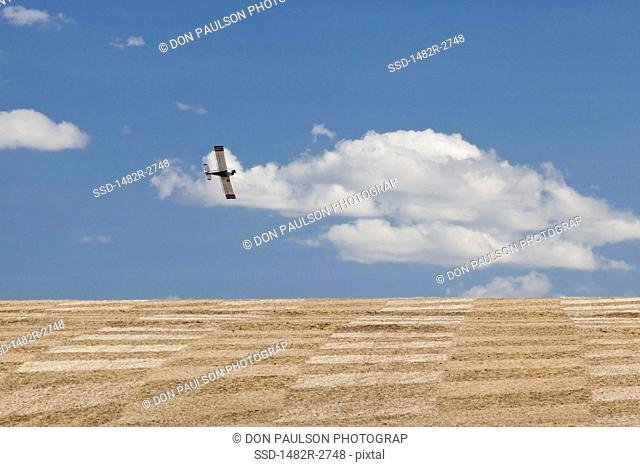 USA, Oregon, Wasco, Crop sprayer over fields