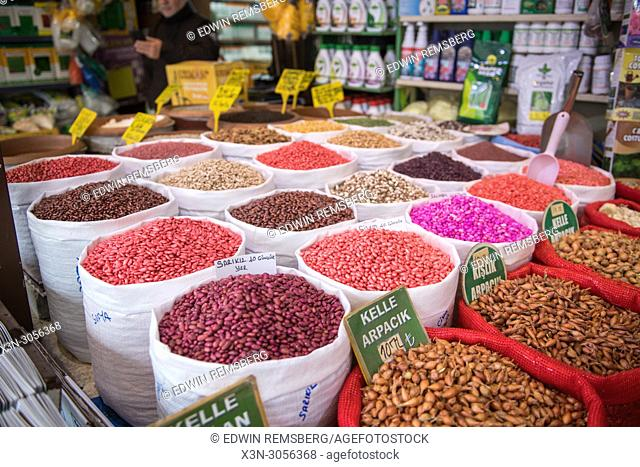 Bags full of an assortment of colorful seeds for purchase at outdoor marketplace, Istanbul, Turkey