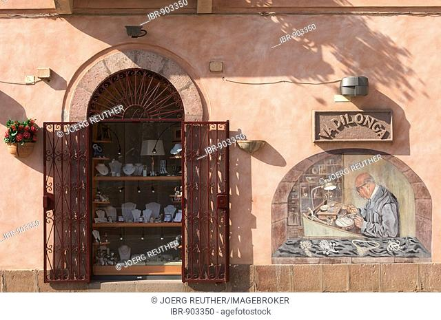 Mural on a jeweller's store in Bosa, Sardinia, Italy, Europe